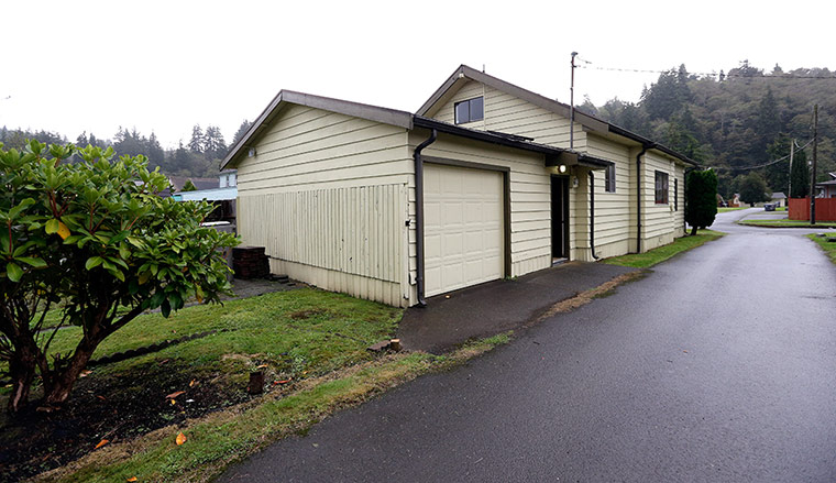 The back of Kurt Cobain's childhood home. Cobain had his bedroom in the att
