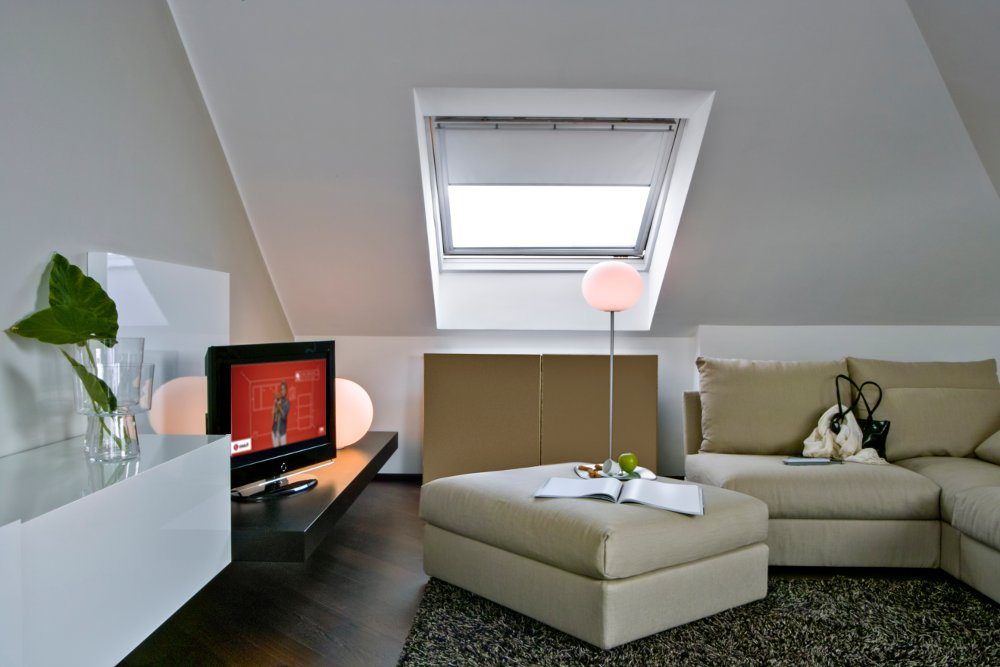 living room with sofa on attic