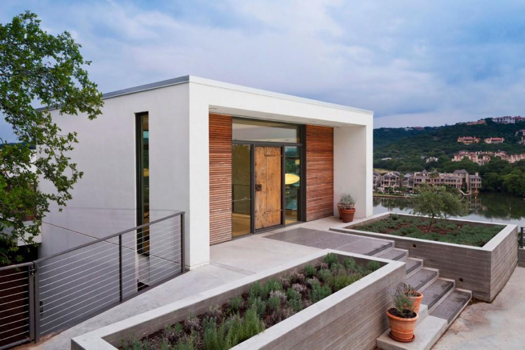 Una casa al lago tra moderna eleganza e un sapiente for Piani di costruzione casa moderna