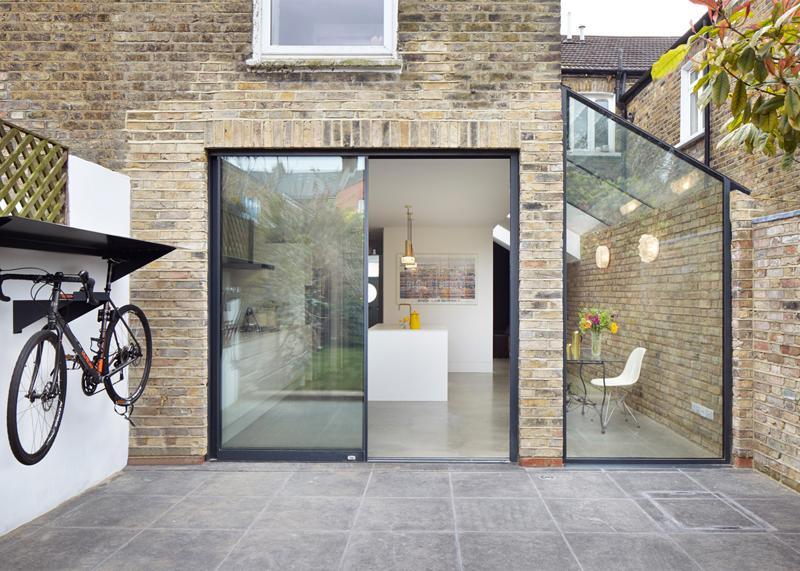 Il luminoso ampliamento di una casa di londra for Piani di casa cottage con veranda protetta