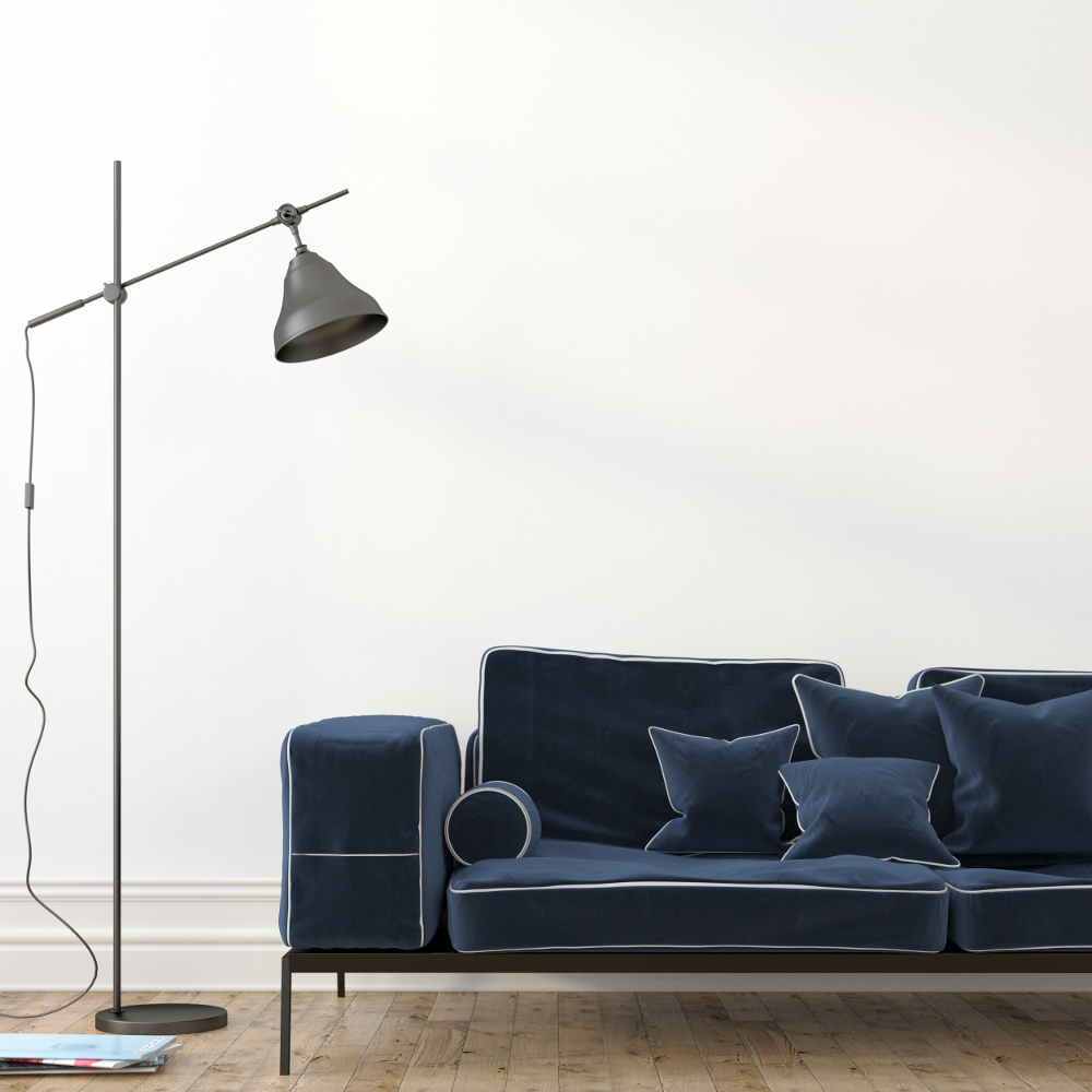 Minimalistic interior with a stylish blue velvet sofa and a modern black floor lamp